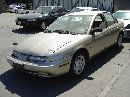 1999 SATURN SL2 1.9L DOHC AT  COLOR GOLD