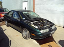 1997 SATURN SL2 4 DOOR SEDAN 1.9L DOHC AT COLOR GREEN STK 129828